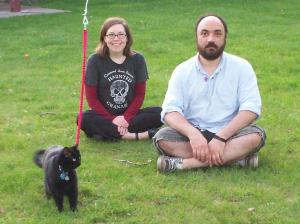 Sarah, Chris and thier cat in the backyard
