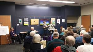 Poet laureate's Sarah and Wendy with a county government office, the Dane County Water Commission, which held a photo and poetry exhibit to celebrate its 25th anniversary in 2013.
